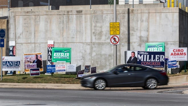 Campaign signs fill the grass around the intersection of North Broom Street and Concord Avenue in Wilmington on Wednesday afternoon.