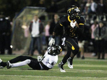 Elijah Barnwell (right) rushed for 120 yards and three touchdowns as Piscataway defeated East Brunswick on Friday.