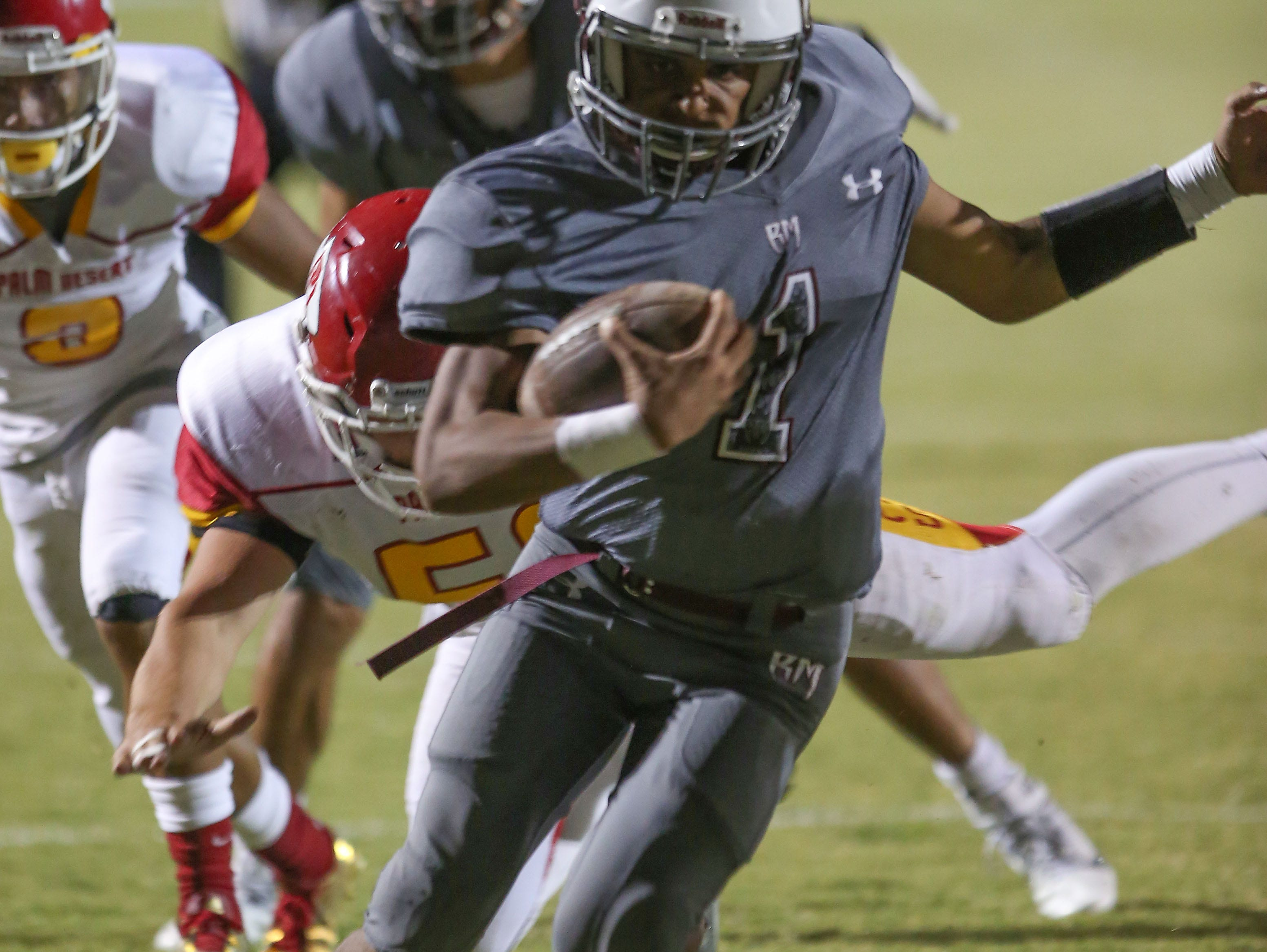 Marquus Prior of Rancho MIrage runs the ball for a touchdown against Palm Desert, September 15, 2016.