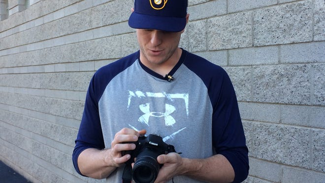 Milwaukee Brewers relief pitcher Rob Scahill describes how to work a camera outside the clubhouse at Maryvale Baseball Park in Phoenix on Tuesday, Feb. 21, 2017.