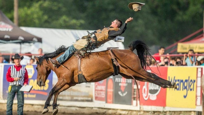 Casey Meroshnekoff of Red Bluff rides in the 2015 Redding rodeo. The 24-year-old is competing in bareback riding this year in Redding on Thursday.