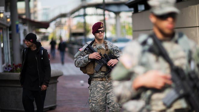 Members of the National Guard patrol along the Inner Harbor in the aftermath of rioting following Monday's funeral for Freddie Gray, who died in police custody, Thursday, April 30, 2015, in Baltimore. In an effort to be transparent, authorities have told the community they plan to turn over the findings of a police investigation into Gray's death to a state's attorney by Friday. (AP Photo/David Goldman)