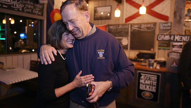 Sam Whitson hugs his wife Pam after learning the final election results at his election party in Franklin  Tuesday, Nov. 8, 2016.