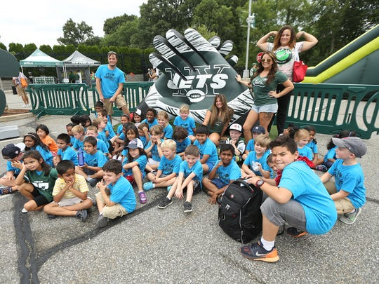A group from Kindercare in Whippany poses for a photo as the New York Jets invite youth football players and summer campers to training camp. August 16, 2016, Florham Park, NJ