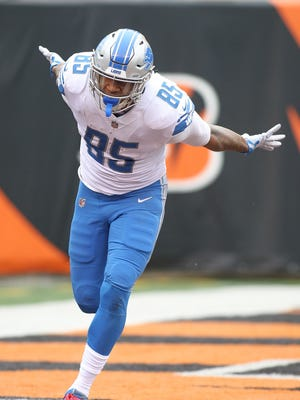 Eric Ebron celebrates after a touchdown against the Bengals at Paul Brown Stadium on Dec. 24, 2017 in Cincinnati.