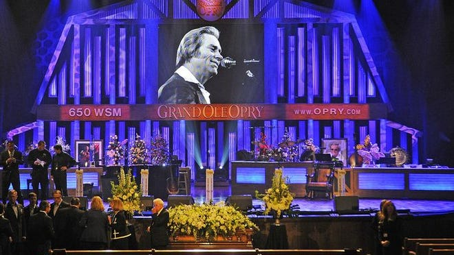 The casket sits alone before the stage before the funeral service for country music legend George Jones at the Grand Ole Opry House in Nashville.