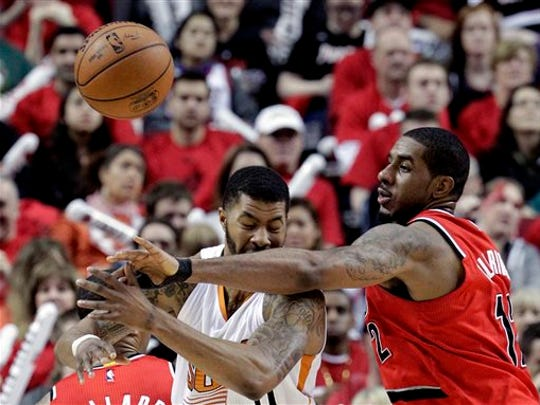 Portland Trail Blazers forward LaMarcus Aldridge, right, knocks the ball out of the hands of Phoenix Suns forward Markieff Morris during the second half of an NBA basketball game in Portland, Ore., Thursday, Feb. 5, 2015. The Trail Blazers won 108-87.
