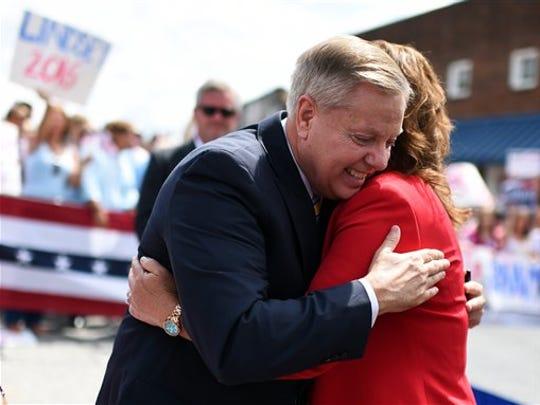 Sen. Lindsey Graham, R-S.C., left, hugs his sister Darline Graham Nordone, after announcing his bid for presidency, Monday, June 1, 2015, in Central, S.C.