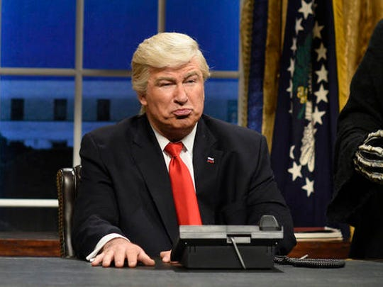"This Feb. 4, 2017 photo released by NBC shows Alec Baldwin as President Donald Trump in the opening sketch of ""Saturday Night Live,"" in New York.  With the return of John Oliver to HBO and Alec Baldwin's guest hosting slot on ""Saturday Night Live,""  this is shaping up like a big weekend for late-night's treatment of the new president."