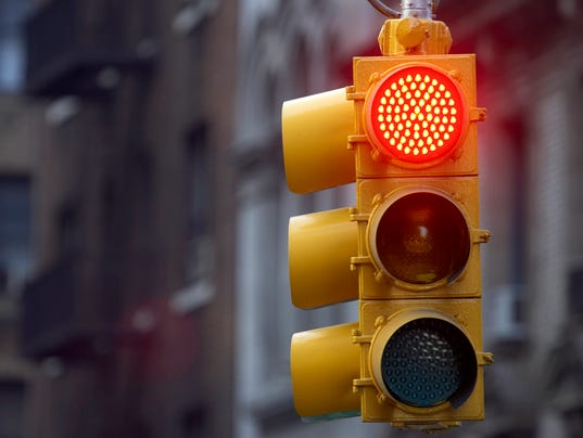 Traffic light on street with red signal lit up