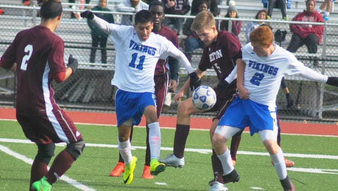North Arlington Vikings' Joshua Gonzales (11) and Anthony DiPopolo (2) battling Becton in the inaugural NJIC tournament title game.
