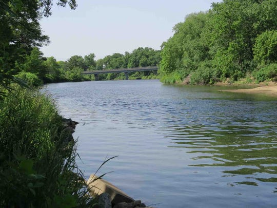 The Maquoketa River flows through Eastern Iowa and provides scenic views near the Highway 13 bridge.