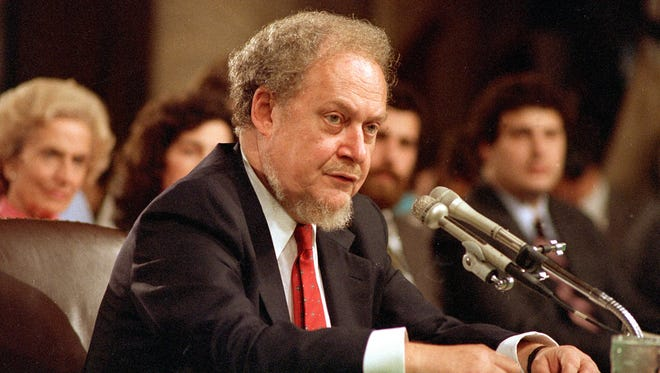 In this Sept. 16, 1987 file photo, U.S. Supreme Court nominee Robert H. Bork testifies before the Senate Judiciary Committee during his confirmation hearings on Capitol Hill.