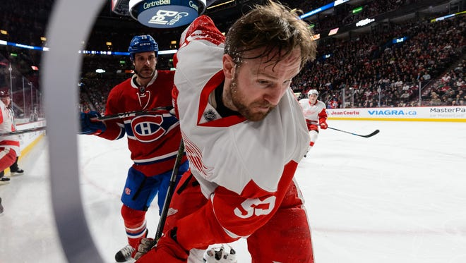 Mike Brown of the Montreal Canadiens roughs up Niklas Kronwall of the Detroit Red Wings near the corner during the NHL game at the Bell Centre on March 29, 2016 in Montreal, Quebec, Canada.