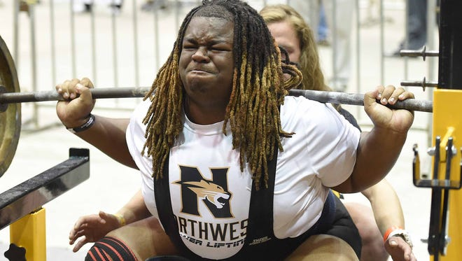 Northwest Rankin's Blaise Thomas squats 700 pounds in the 308 pound weight class competition on Saturday, April 16, 2016, at the MHSAA State Powerlifting Championships in the MIssissippi Coliseum in Jackson, Miss.
