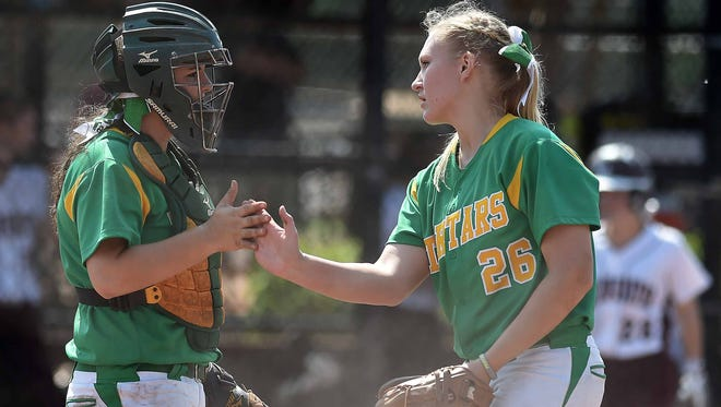 Taylorsville pitcher Lauren Stringer and catcher Emily Vowell celebrate an out against East Webster on Thursday in Game 1 of the Class 2A championship series at Freedom Ridge Park in in Ridgeland.