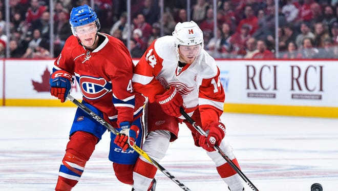 Daniel Carr and Gustav Nyquist go for the puck Saturday night.