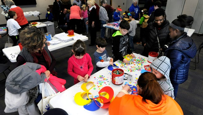 Several parents stand by their children as they create their own artwork Saturday morning during the Arts Smarts for Kids! event at the Henderson Community CollegeÕs Preston Arts Center in Henderson, Saturday, Feb. 4, 2017. Several art stations were available for the kids as a harpist played background music for the participants.