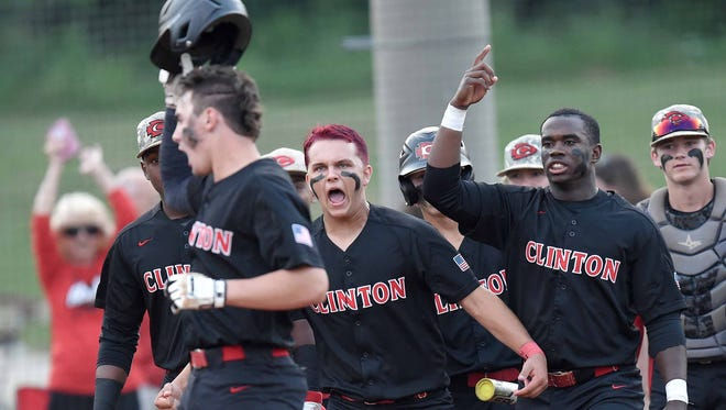 The Clinton Arrows celebrate as Walker Burchfield crosses home plate after hitting a two-run homer against Southaven on Friday in the MHSAA Class 6A baseball playoffs at Clinton.