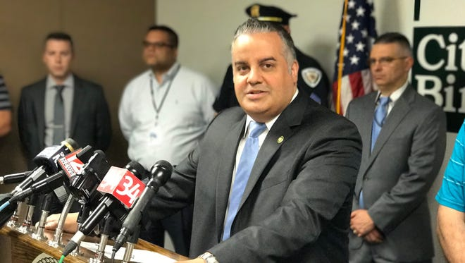 Binghamton Mayor Richard David speaks at a news conference Monday about two recent homicides.