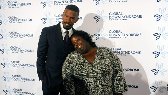 Actor Jamie Foxx accompanies his sister, DeOndra Dixon,
