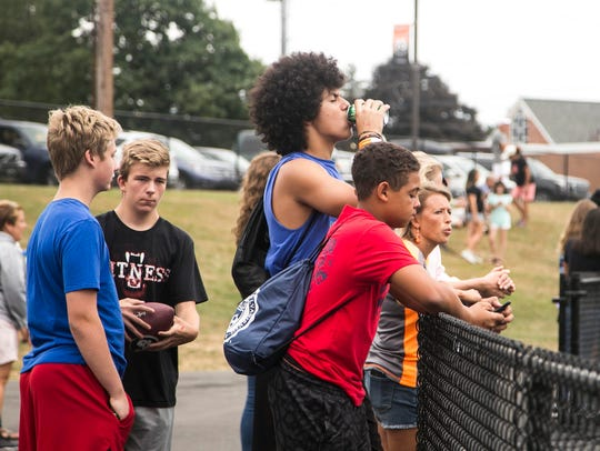 Fans look on during the first quarter of a football