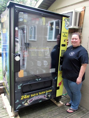 Melissa Rinker, who owns Swarthout's Bait & Tackle Shop in Elmira, shows off the state-of-the-art live bait machine she just purchased.
