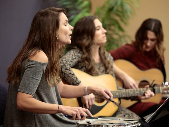 Callie Guidry, left, performs with Sweet Cecilia at