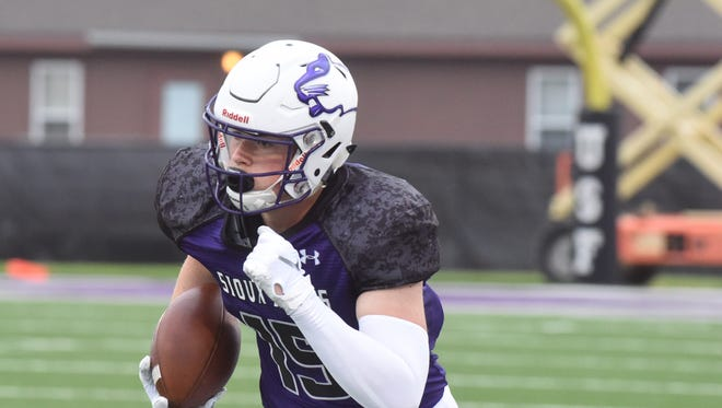 University of Sioux Falls Ty Smith (15) runs the ball during a game against Concordia University, St. Paul on Thursday, Aug. 30, 2018 at Bob Young Field in Sioux Falls, S.D.