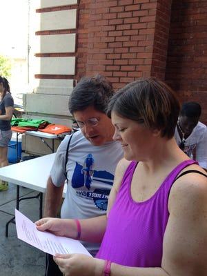 Greg Hartley and his wife, Nancy Hartley look over the clues for the Urban Challenge Saturday.