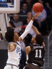 UCLA's Chris Smith (5) blocks a shot by St. Bonaventure's Courtney Stockard (11) during the first half of a First Four game of the NCAA men's college basketball tournament, Tuesday, March 13, 2018, in Dayton, Ohio.