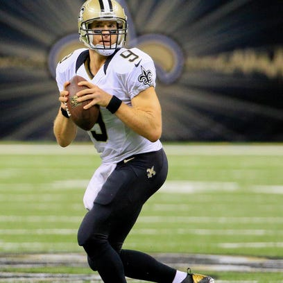 Quarterback Drew Brees drops back to pass during the Saints' game against Tampa Bay last month. New Orleans expects Brees to play during Sunday's game against Dallas.