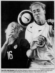 Enquirer newspaper coverage of a 2004 soccer match between the U.S. women's national team and New Zealand.