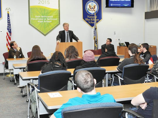 Teachers Michael Buonaguro, left, and Eric Menell flank Rep. Frank Pallone Jr. (D-6th Dist.) as he addresses 40 seniors on the East Brunswick campus of the Middlesex County Vocational and Technical Schools.