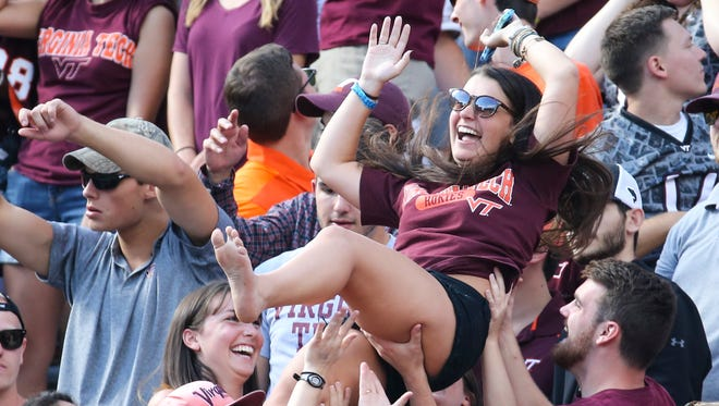 Tech students celebrate Hokies' score in the second quarter at Lane Stadium in Blacksburg, Va. Saturday.