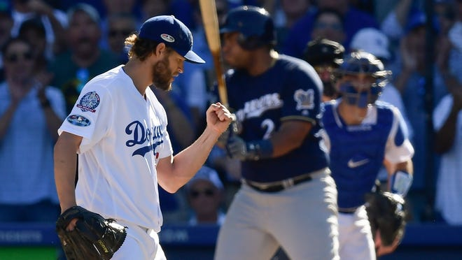Los Angeles Dodgers starting pitcher Clayton Kershaw reacts after getting Milwaukee Brewers' Jesus Aguilar to strike out with bases loaded during the third inning of Game 5 of the National League Championship Series baseball game Wednesday, Oct. 17, 2018, in Los Angeles. (AP Photo/Mark J. Terrill)