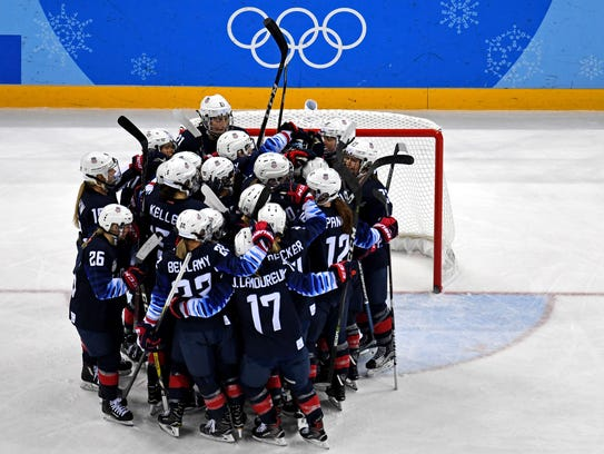 The United States celebrates beating Finland in the