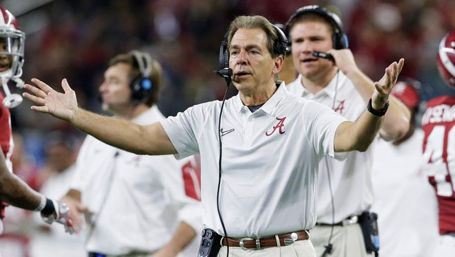 Alabama coach Nick Saban gestures to his players during the second half of the Cotton Bowl NCAA college football playoff semifinal playoff game against Michigan State on Thursday, Dec. 31, 2015, in Arlington, Texas.