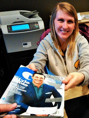 Katie Easton, patient service coordinator at MercyCare in North Liberty, cheerily accepts the return of a GQ magazine pilfered from the clinic lobby.