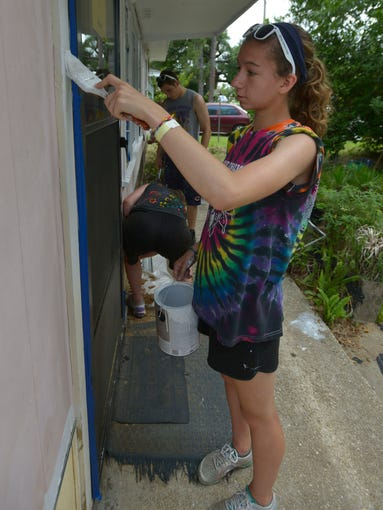 Grace Avery is spending part of her summing in Pensacola helping low-income and elderly residents repair and upgrade their homes. The week log mission trip brings together church youth groups from around the county into local communities to assist area resident with free home improvements.
