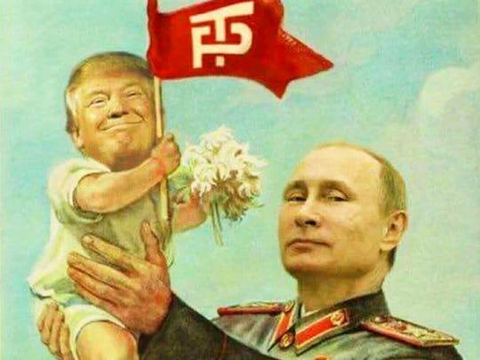 A proud dad raises his son.