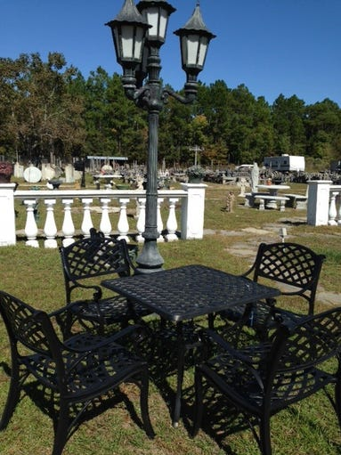 Cast aluminum lattice table and chairs and street light