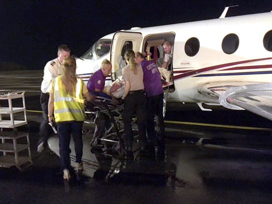 Rick Autrey is put on a medivac jet to take him back