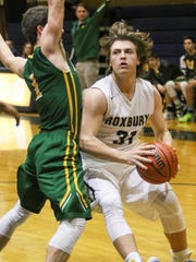 Roxbury's Will Findlay goes to the basket as Morris
