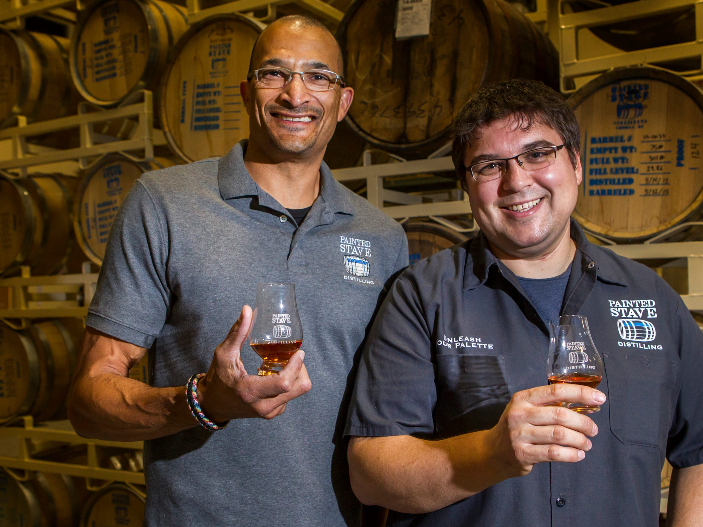 Painted Stave's Ron Gomes Jr. (left) and Mike Rasmussen pose for a portrait at the distillery in Smyrna on Tuesday night.