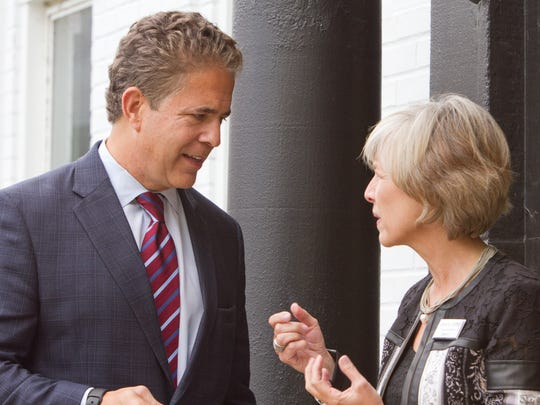 U.S. Rep. Mike Bishop talks with Carol Griffith, vice chairman of the Livingston County Board of Commissioners, after an event held at the Brighton Chamber acknowledging the U.S. Chamber of Commerce endorsement of Bishop.