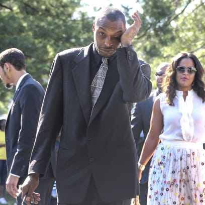 Muhammad Ali, Jr. and Laila Ali arrive at the funeral