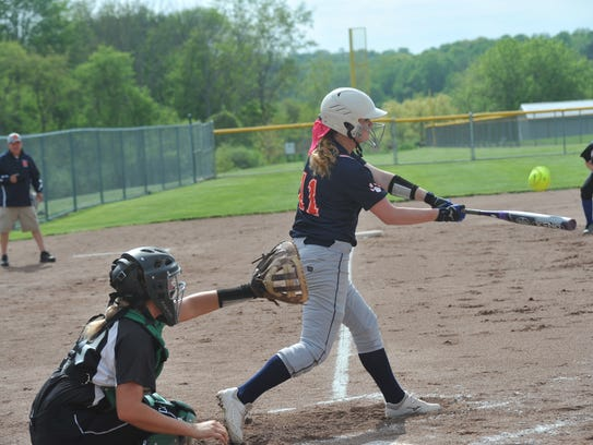Gracie Groves swings at a pitch against Clear Fork