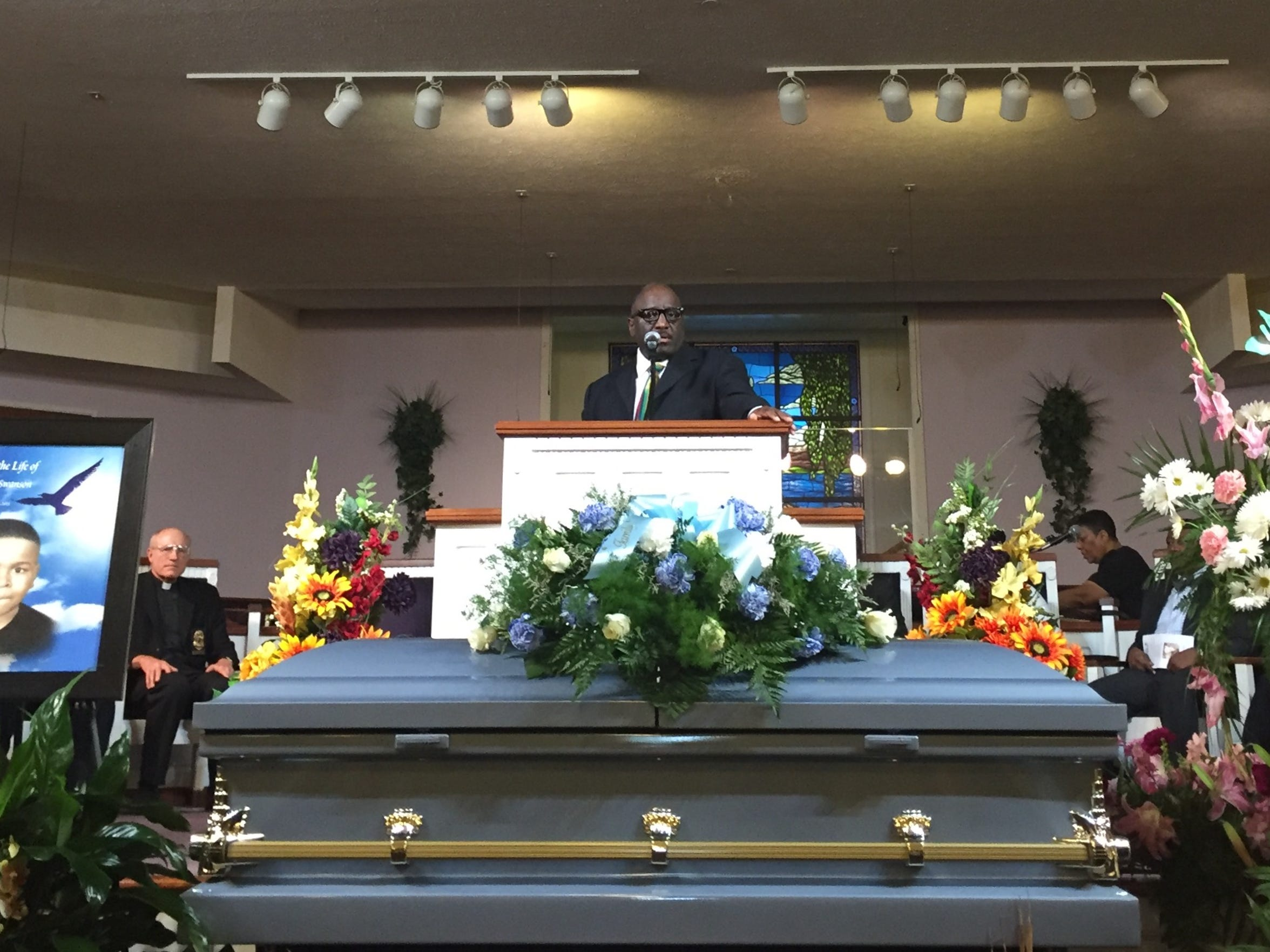 Chaplain David L. Coatie of the Indianapolis Metropolitan Police Department spoke at the funeral for Deshaun Swanson on Sept. 28, 2015. Deshaun, 10, was gunned down Sept. 19.