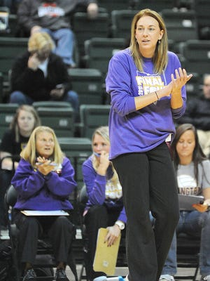 Lexington volleyball coach Bobbi Weaver encourages her team during the Division II state semifinal at Wright State's Nutter Center  on Thursday.